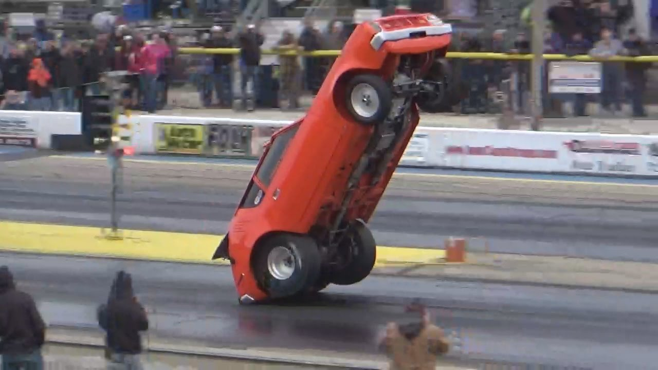 American Muscle Cars Doing Wheelstand Wheelies Down The