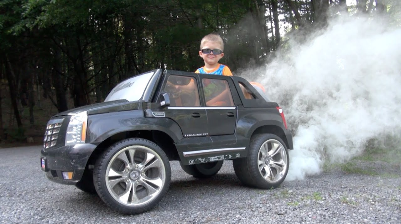 an awesome power wheels escalade makes wonderful burnout with smoke an awesome power wheels escalade makes