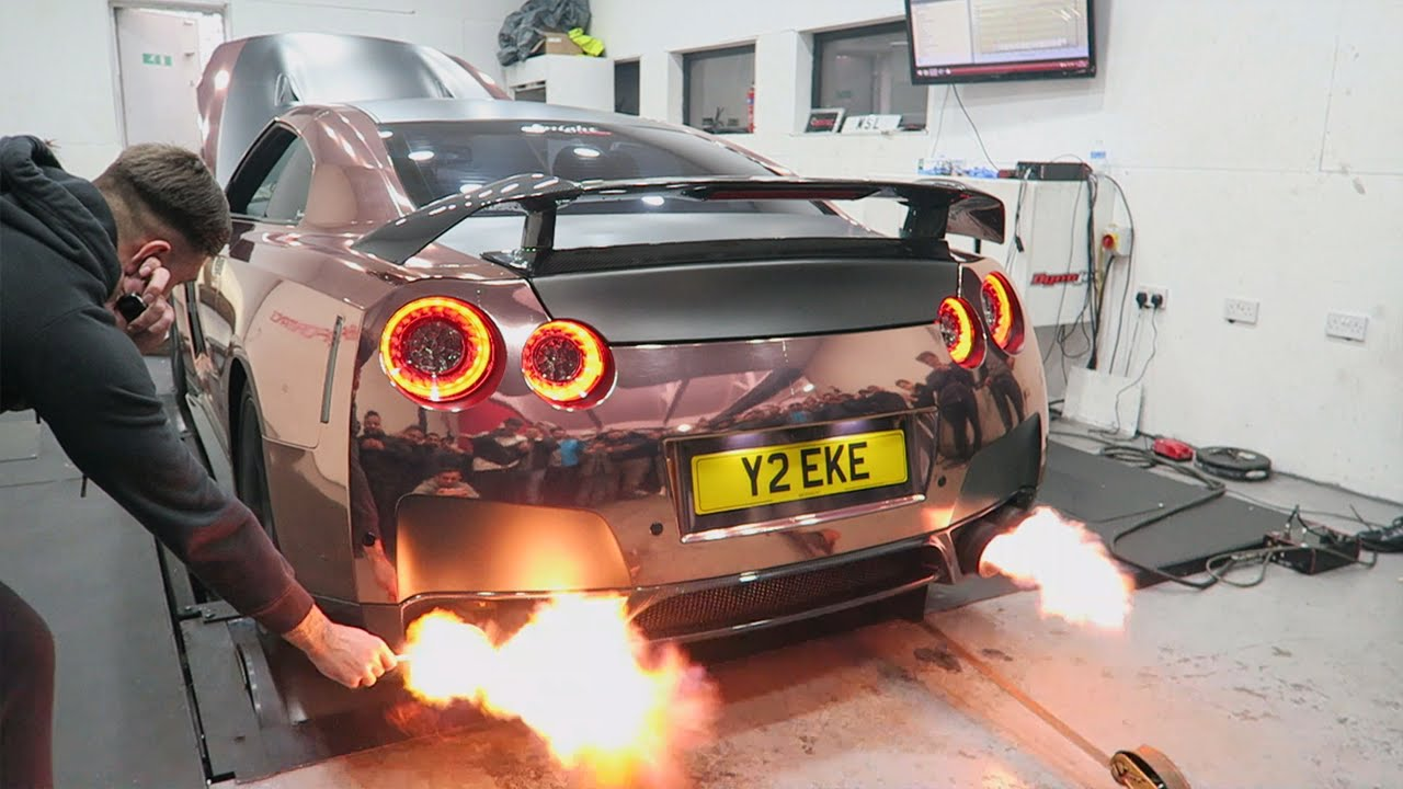 Trying To Light A Cigarette On The Exhaust of the GT-R Goes