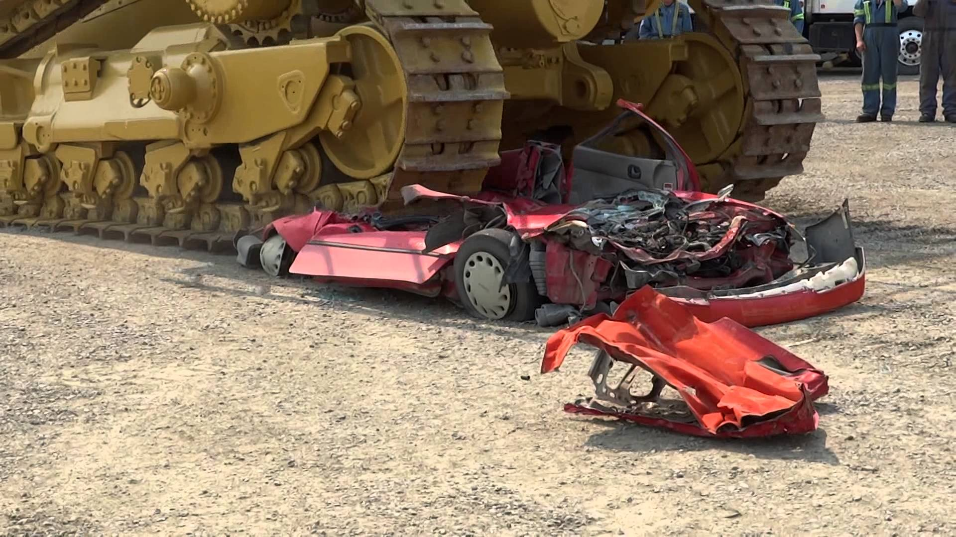 Pontiac Firefly Meets Death Via Caterpillar D11 Buldozer